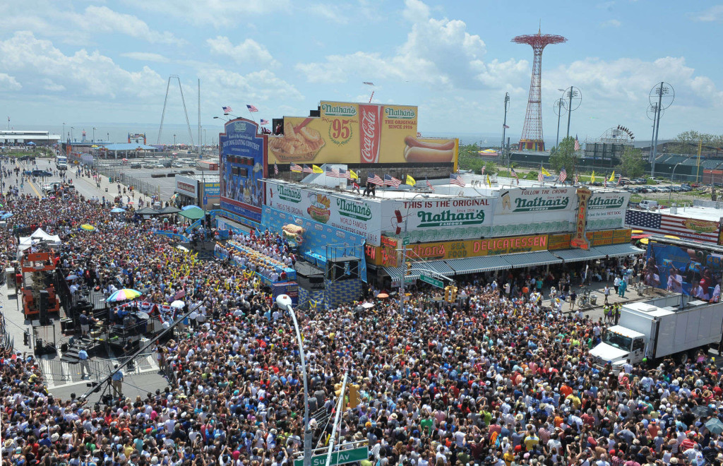 "July 4th, 2013. The annual Nathan's hot dog eating contest in Coney Island Brooklyn. Estimated 30-40 thousand came to watch the event on Stillwell & Surf avenues, Joey ""Jaws"" Chestnut sets a new record and wins the Nathan's Famous Fourth of July Hot Dog Eating Contest in Coney Island with a new world record of 69 hot dogs and buns in 10 minutes. The win gave Chestnut seven titles in a row, another record. Sonya ""The Black Widow"" Thomas won the women's contest but narrowly eating 36 and three-quarters hot dogs and buns to Juliet Lee's 36. The 100-pound Thomas (of Alexandria, Va) has won the women's contest for all three years."