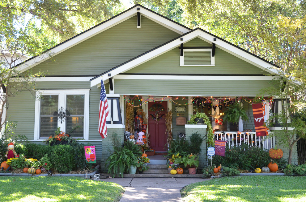Splashy-Sage-Green-Paint-fashion-Dallas-Craftsman-Exterior-Decorators-with-american-flag-bungalow-covered-porch-front-porch-gable-roof-green-house-green-siding-halloween
