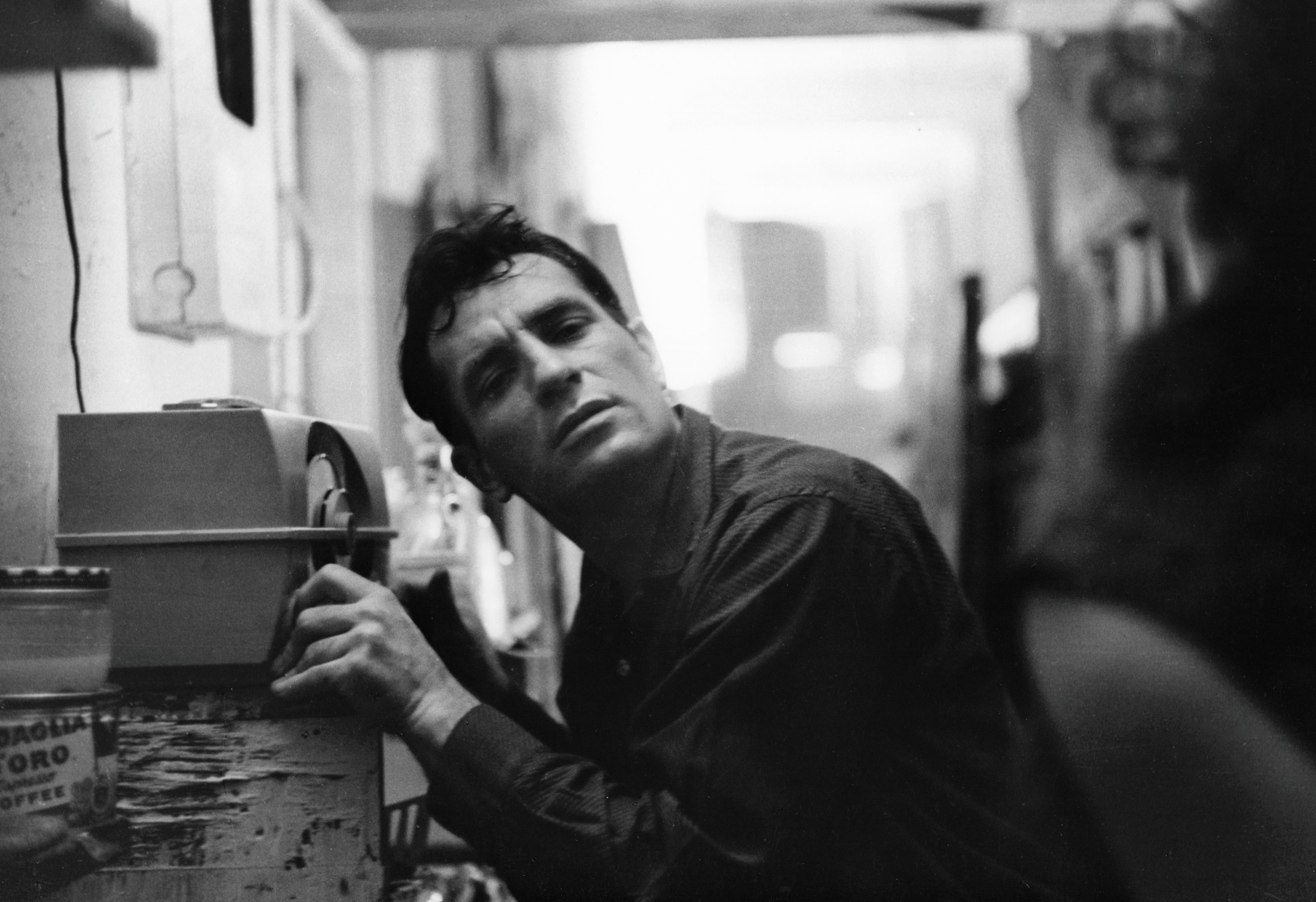 American Beat writer Jack Kerouac (1922 - 1969) leans closer to a radio to hear himself on a broadcast, 1959. (Photo by John Cohen/Getty Images)